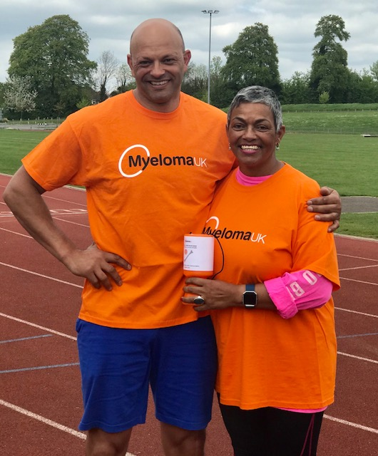 Carmen Lester and her brother Rafer in orange Myeloma UK t-shirts