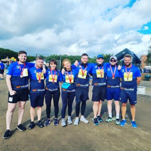 Myeloma supporter Melissa at the Belfast Marathon in a group of friends with arms round each other