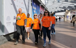Charles with his friends and family walking in a group wearing orange Myeloma UK t-shirts